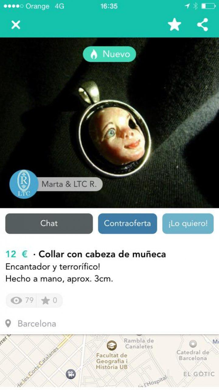 COLLAR CON CABEZA DE MUÑECA
